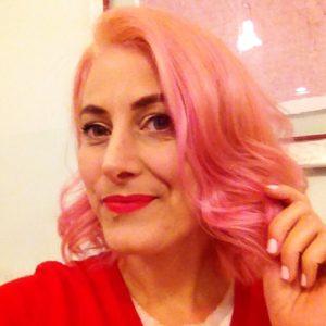 Decolorare i capelli tinti di rosso